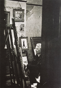 "Lowry in his studio with Isherwood's ""Minnie the cat"" second from top Copyright Harold Riley"